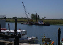 Tug boat and spud barge after repairing dock pilings at Bethel Island